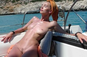 Free and Wild 15 - Dominika sunbakes on yacht