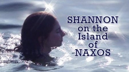 Shannon swims on a beach in Naxos, Greece