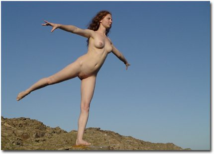 Shannon poses naked on a hill in Paros, Greece.